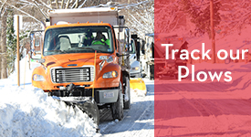 Snowplow with text reading Track Our Plows