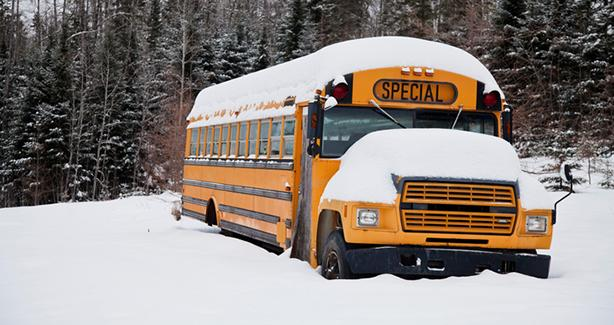 Schoolbus covered in snow