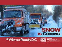 Snow plows and Snow Is Coming text